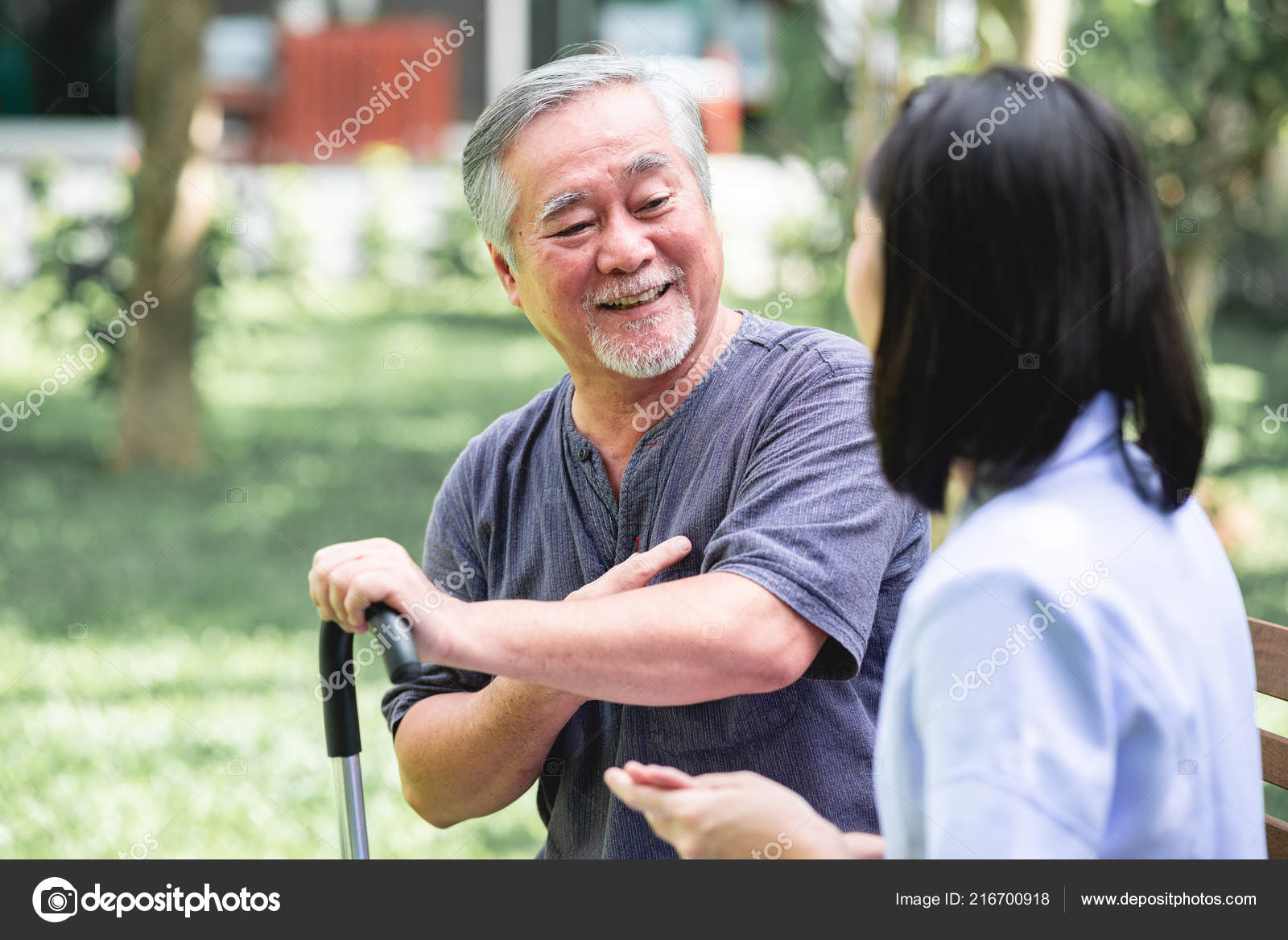 Nurse Patient Sitting Bench Together Talking Asian Old Man