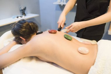 Massages with hot stones in beauty center