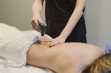 Massages with suction cups in beauty center
