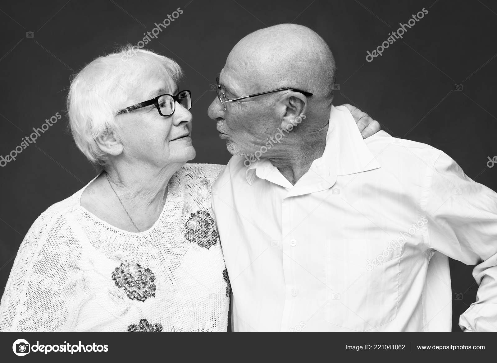 Relationship old age people concept black white portrait senior couple stock photo