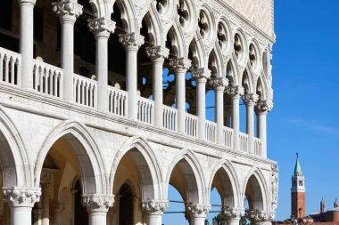 Venice, Doge palace open gallery and San Giorgio Maggiore bell tower in a sunny summer day in Italy