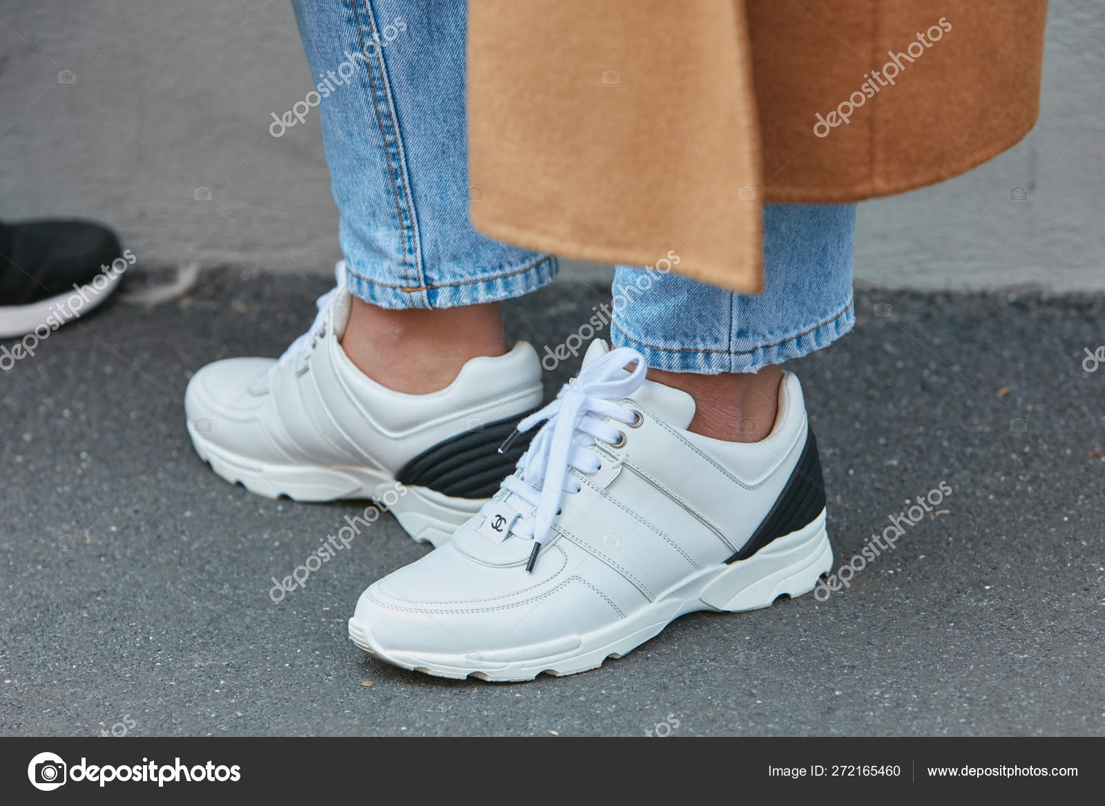 Woman with white Chanel shoes and blue