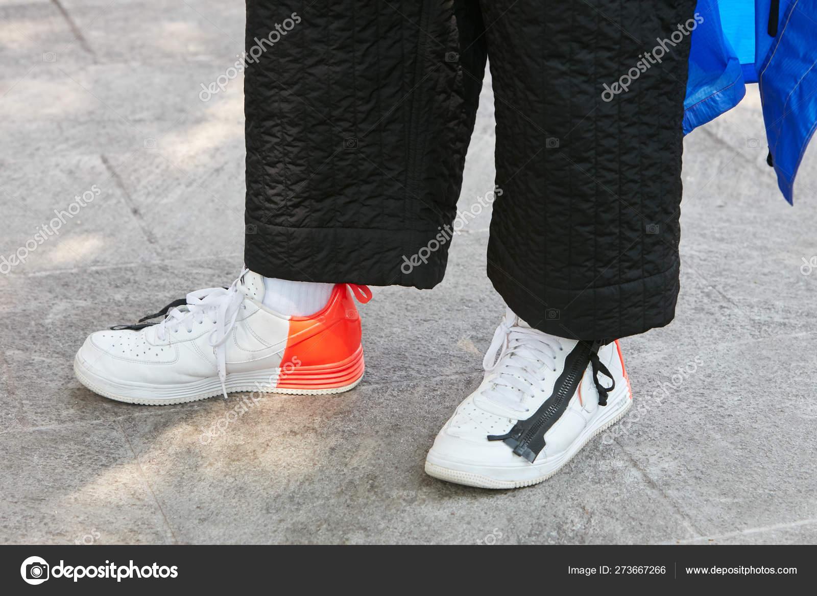 primo sguardo ufficiale godere del prezzo di liquidazione Man with white, orange and black Nike before Emporio Armani ...
