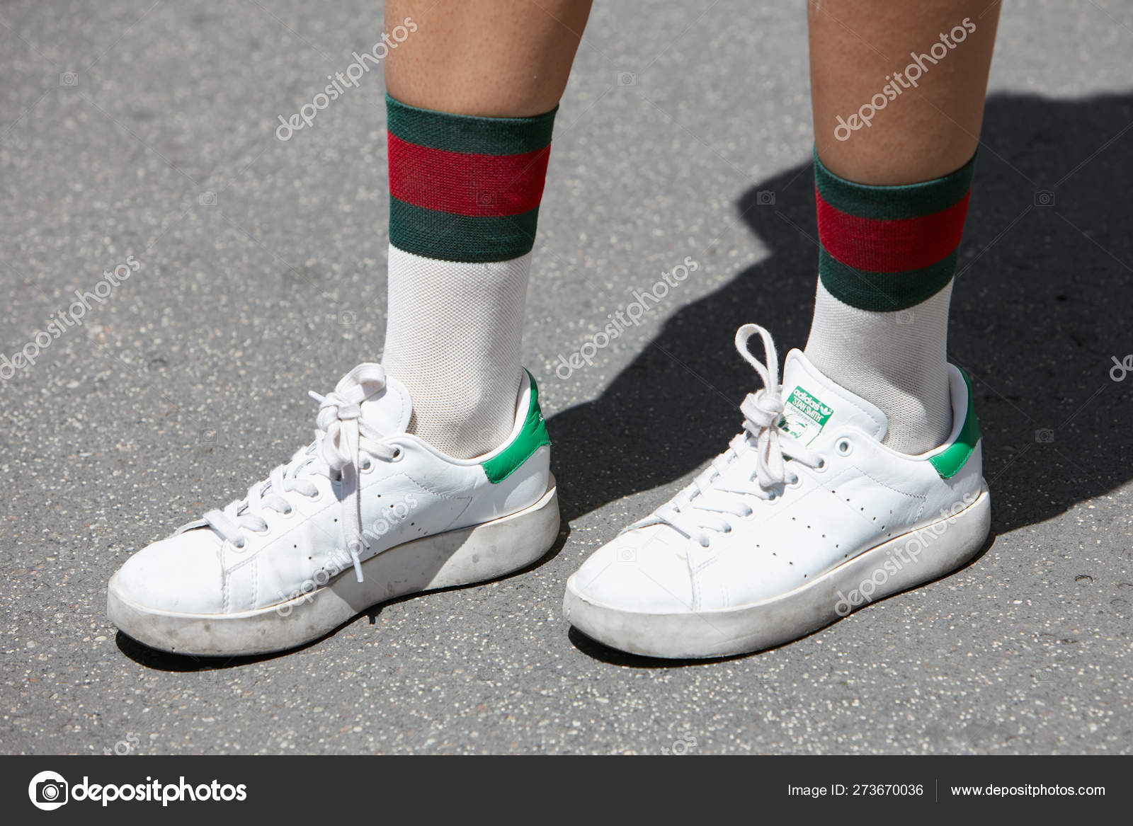 detailed look e9e48 2650f Woman with white and green Adidas Stan Smith shoes and Gucci ...