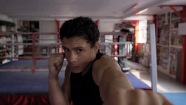 Portrait of woman practicing boxing in gym