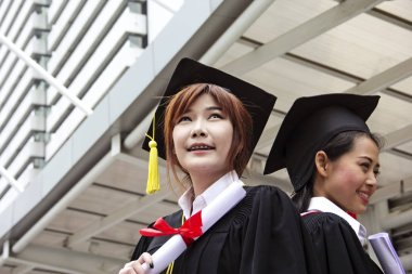 Pretty female students happy smiling for Graduation.