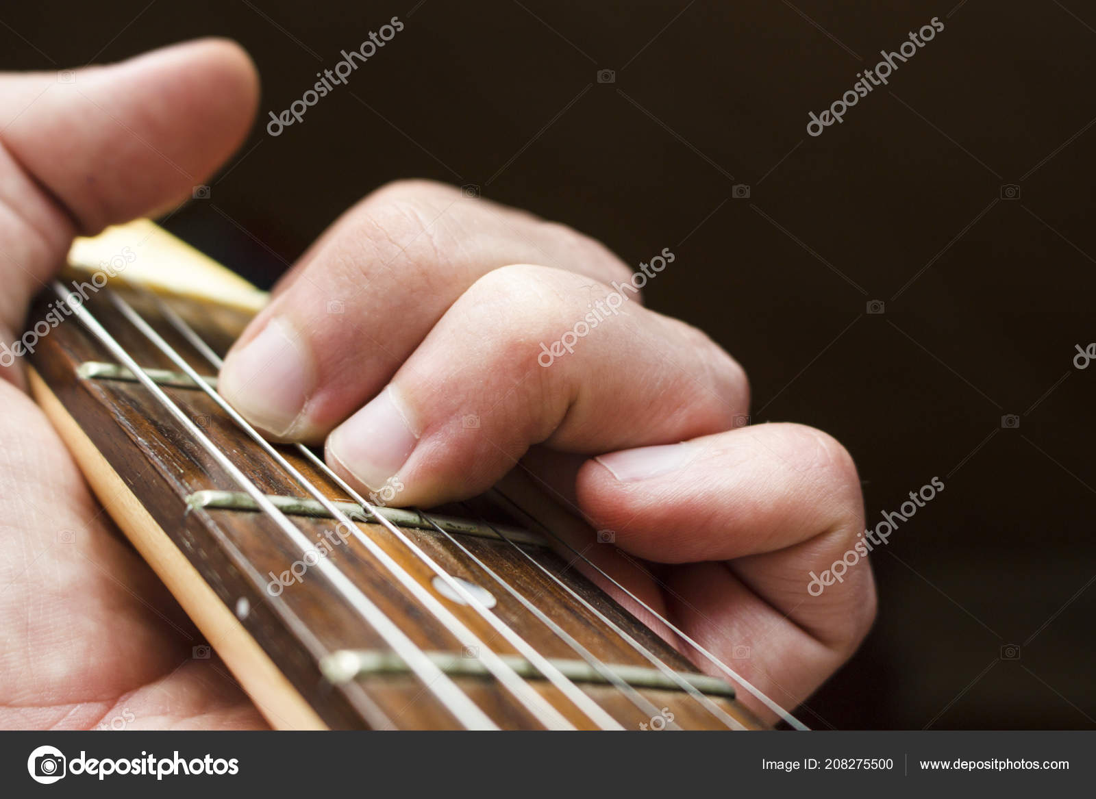 Man Hand Holds Chord Guitar Fretboard Stock Photo Granevsergey