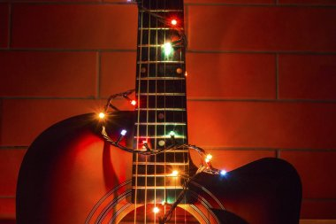 acoustic guitar in a garland