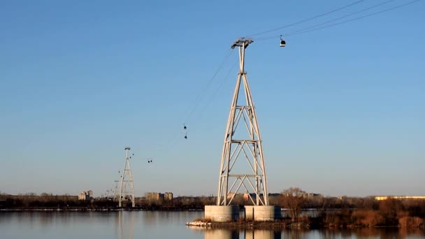 Cable car over the river against the blue sky and clouds, time lapse
