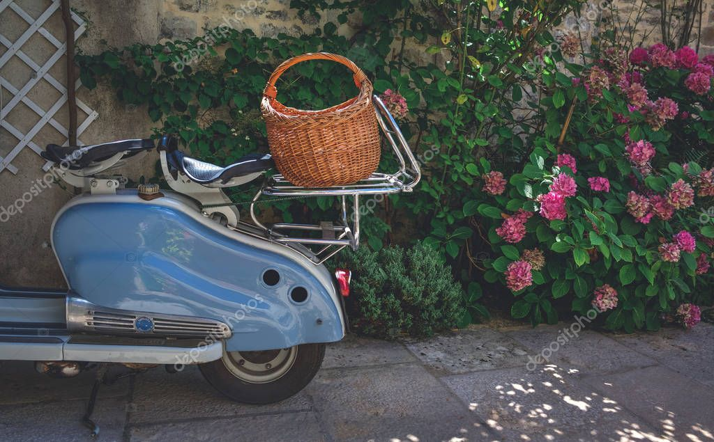 Scooter parked on a terrace in france