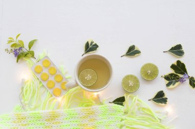 mix honey lemon healthy drinks ,lozenge with scarf knitting wool of lifestyle woman relax in winter season on background white