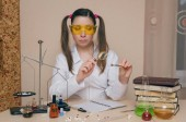 Emotional student girl on chemistry lesson. Pharmacist or apothecary woman. Scientific experiment background. Funny intern in chemical laboratory concept.