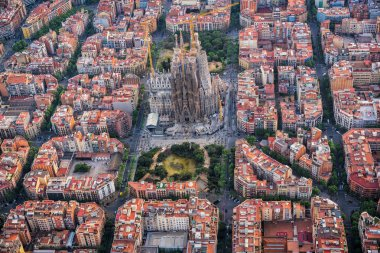 Aerial view of Eixample residential district and Sagrada Familia Basilica, Barcelona, Spain