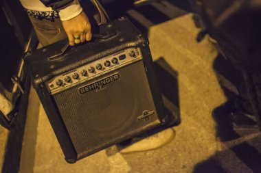 Hand carries a guitar amp