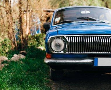 Old blu luxury vintage russian car. volga 24. old antique car little bit rusty. shiny blue paint