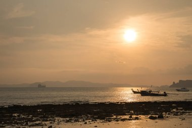 beautiful beach and boat in Krabi Thailand with sunrise
