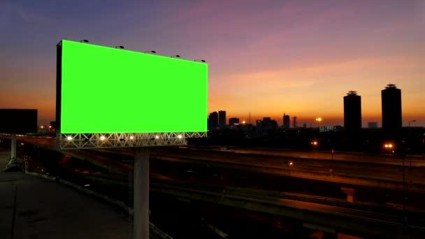 4K of Advertising billboard, green screen, at sunset near expressway. time lapse.