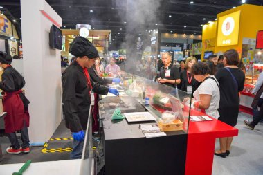 Chefs are cooking demonstrations to visitors and customer
