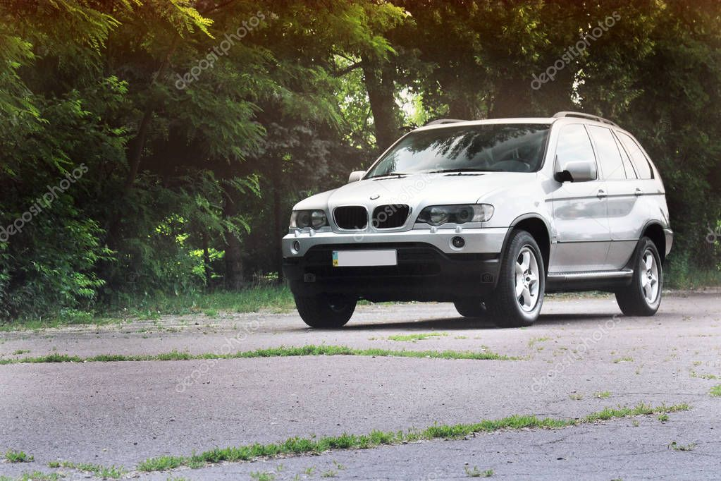 Kiev, Ukraine - June 16, 2018: BMW X5 on the road in a beautiful forest