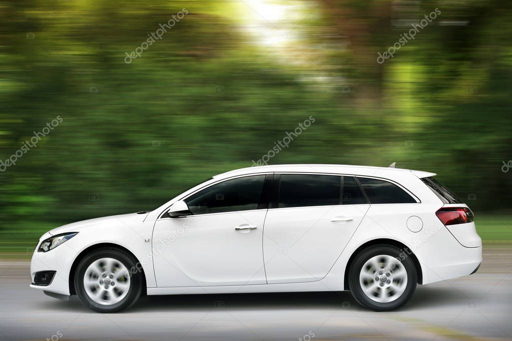 Brovary, Ukraine - June 21, 2018: White family car Opel in the forest on the road