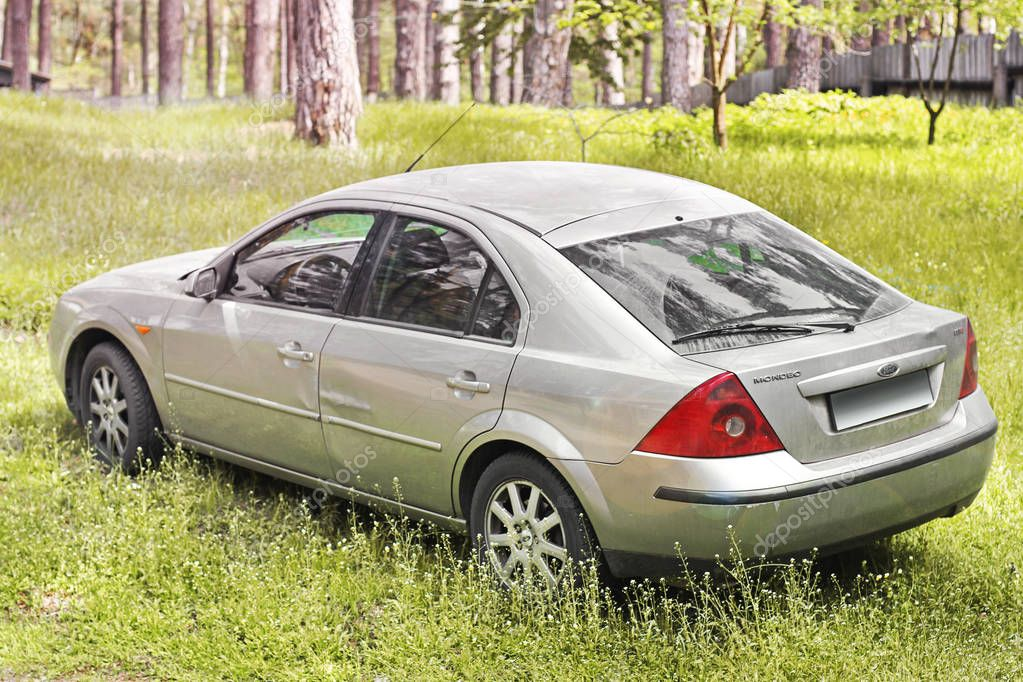 Kharkov, Ukraine - May 9, 2018: The gray Ford Mondeo car is in the forest. Back view