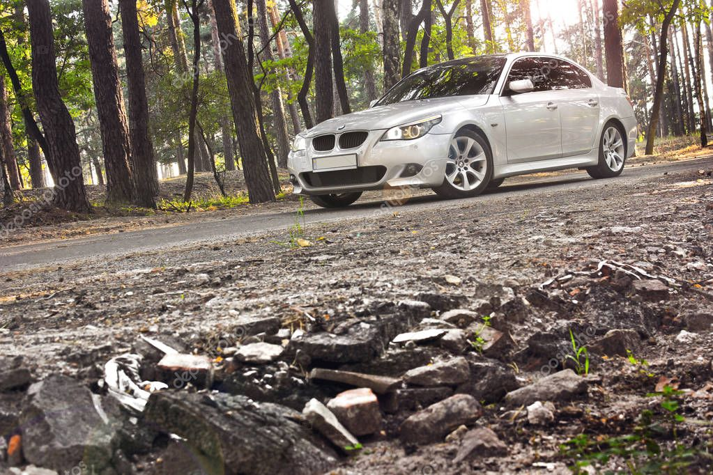 Kiev, Ukraine - September 16, 2018: BMW in the forest. View of the car from the bottom