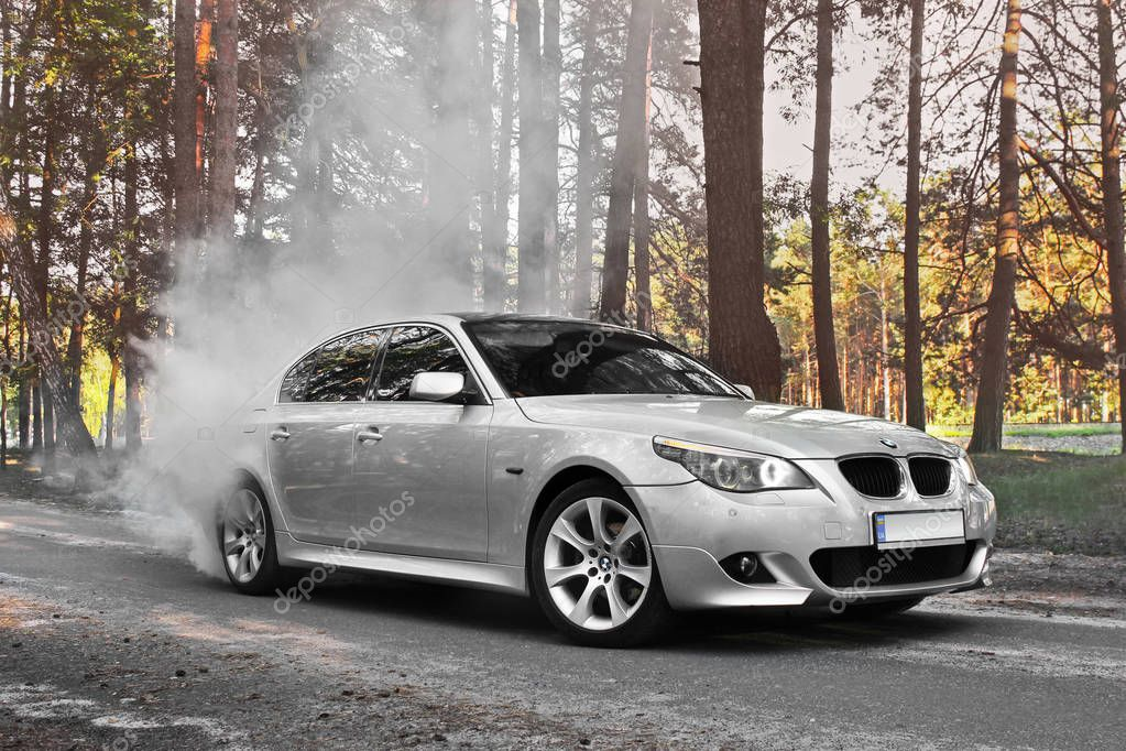 Kiev, Ukraine - September 9, 2018. BMW E60 Burnout. BMW car Drifts in the forest
