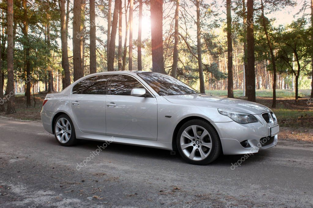 Kiev, Ukraine - September 12, 2018: BMW in the forest on the road