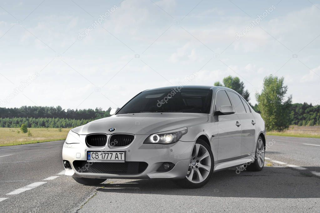 Kiev, Ukraine - September 9, 2018. BMW E60 on the road against the sky