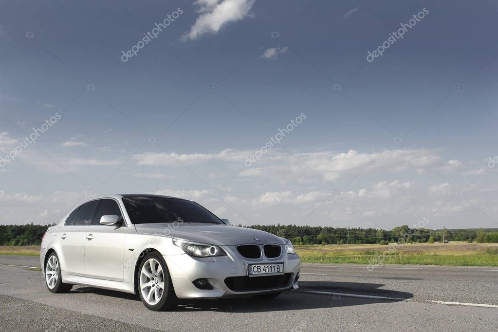 Kiev, Ukraine - September 9, 2018. BMW E60 on the road against the background of the field
