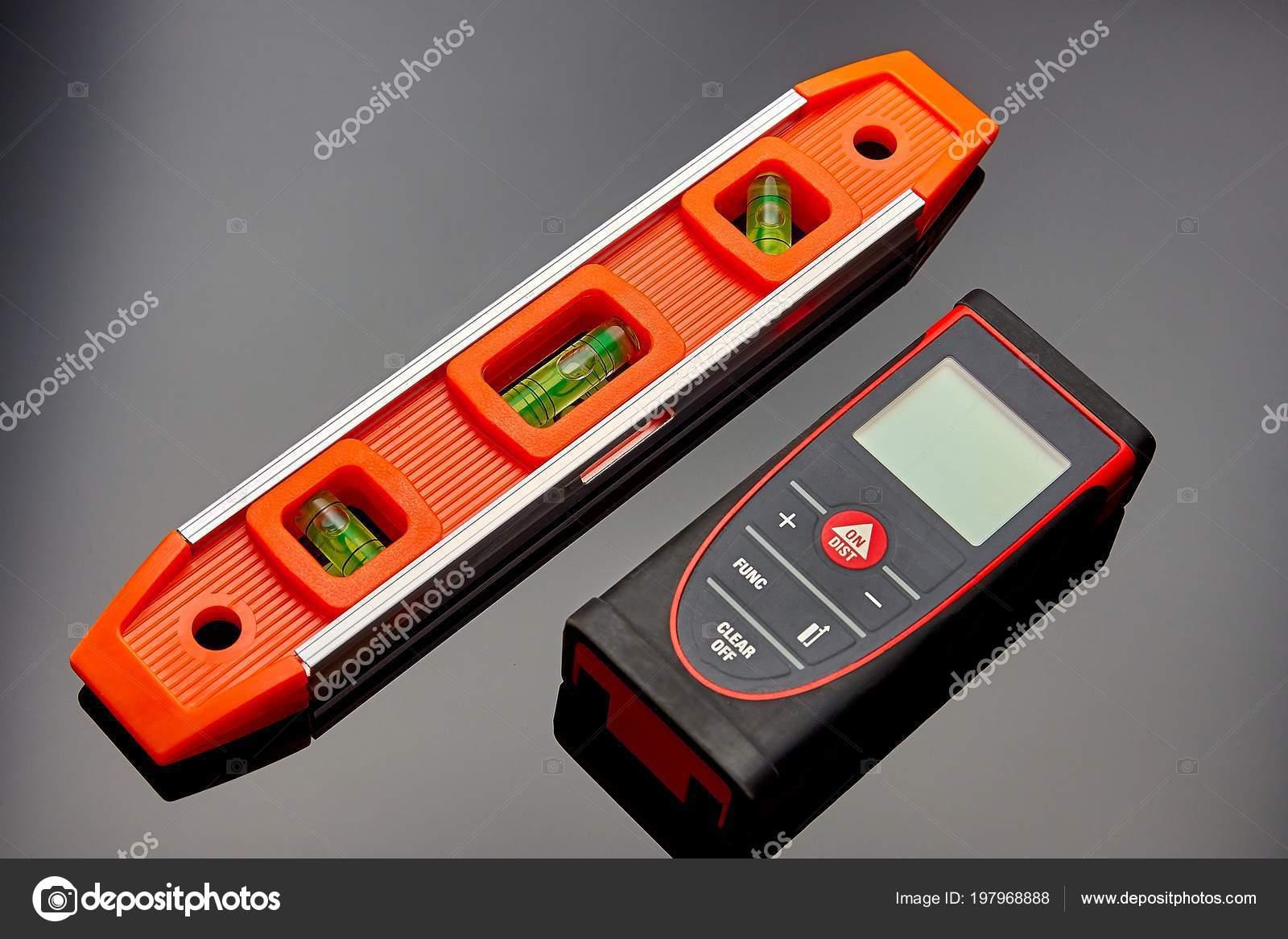 Entfernungsmesser Für Handy : Optischen ebene laser entfernungsmesser und einem bleistift auf dem