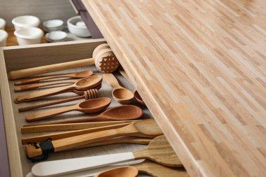 Different utensils in drawer on kitchen