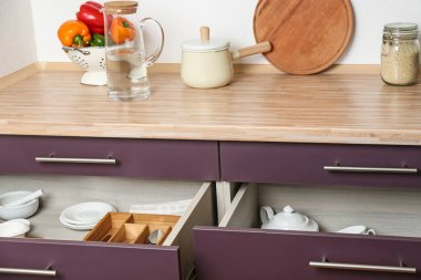 Different kitchenware in drawers