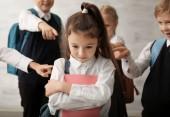 Fotografie Children bullying their classmate indoors