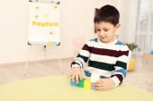 Fotografie Little boy with autistic disorder at child psychologists office