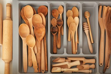 Wooden kitchen utensils in drawer, closeup