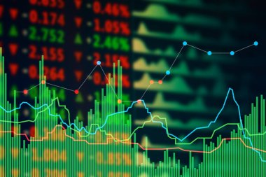 Stock exchange graphs and rates on color background. Financial trading concept