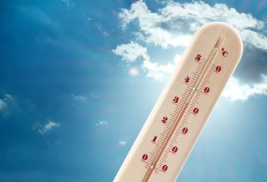 Thermometer showing high temperature and sky on background. Hot summer weather