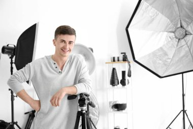Young man posing for professional photographer in studio stock vector