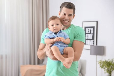 Father with his cute little son at home