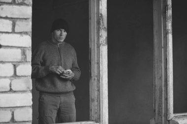 Homeless poor man in derelict building