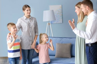 Parents leaving their daughter with nanny at home