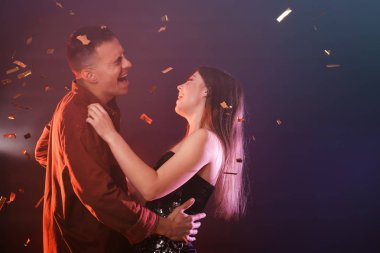Young couple dancing together in night club