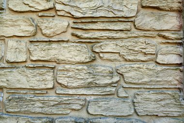 Stone texture background, copy space. Detail of stone abstract background, free space. Decorative uneven cracked stone wall surface