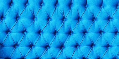Blue buttoned luxury pattern, copy space. Capitone textile background. Chesterfield style, checkered soft fabric furniture upholstery, diamond pattern, decoration with buttons, close up