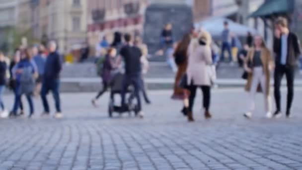 People walking on the streets of Warsaw's Old Town. Unrecognizable people footage.