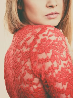 Elegant young woman wearing red lace top. Female presentig stylish fashionable outfit.