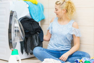 Woman doing black clothes laundry