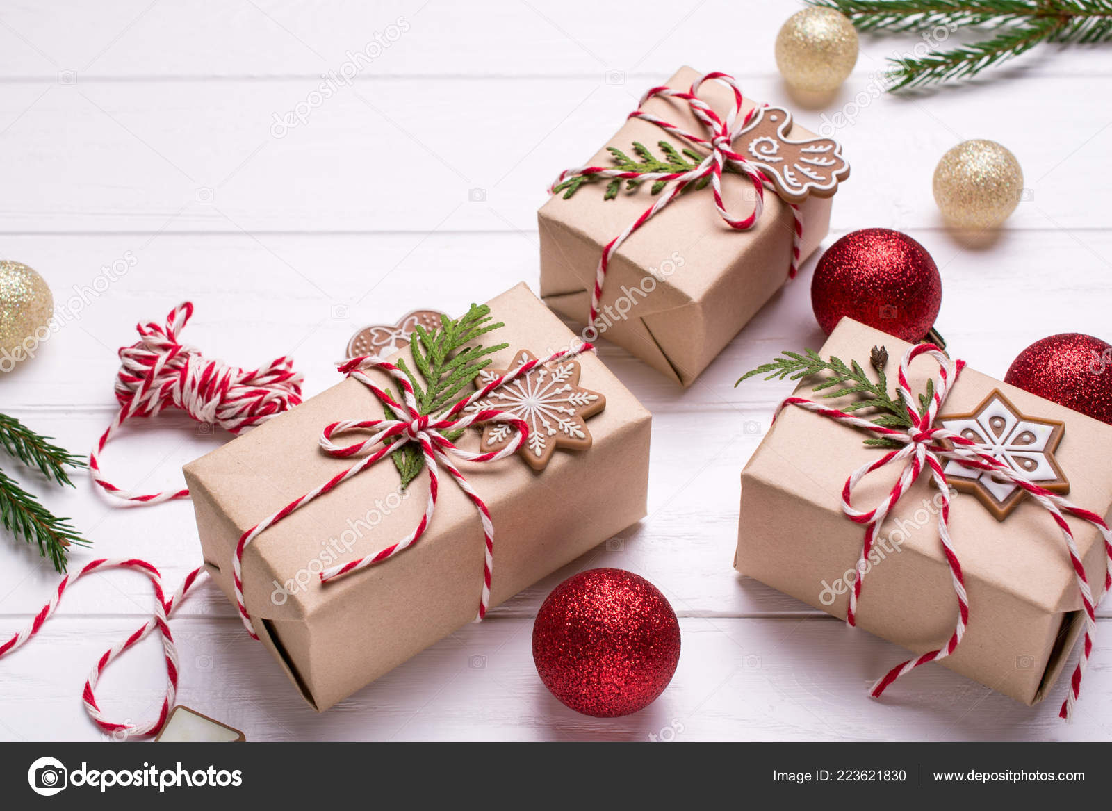 Packing Christmas ts Christmas t boxes and decorations pine branches on white table Present decorated with natural parts with copy space
