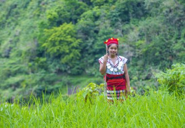 BANAUE, PHILIPPINES - MAY 02 : Woman from Ifugao Minority near a rice terraces in Banaue the Philippines on May 02 2018. The Ifugao minority mostly live in the mountains of north Philippines